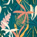 Seamless pattern with tropical leaves on dark green background. Vector design. Jungle print. Floral background.