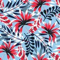 Trending abstract tropical seamless pattern with bright leaves and plants on a light blue background. Vector design. Jungle print.