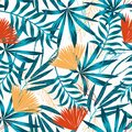 Summer trend seamless pattern with bright tropical leaves, plants and flowers on white background. Vector design. Jung print. Flor