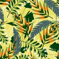 Summer bright original seamless pattern with tropical leaves and plants on a light yellow background. Vector design. Jung print. F