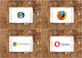 Web browsers internet explorer firefox google chrome and opera logos of on white tablet on rusted wooden background Royalty Free Stock Photo