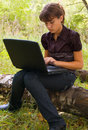 Web browsing in forest Stock Image