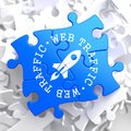 Web traffic concept on blue puzzle written arround icon of go up rocket located internet Royalty Free Stock Photo
