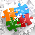 Web traffic concept on multicolor puzzle written arround icon of go up rocket located internet Stock Photos