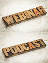 Webinar and podcast words web seminar in vintage letterpress wood type on a ceramic tile background a composite of two images Stock Photo