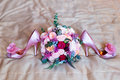Wedding accessories for the morning of the bride in pink . Wedding bouquet and shoes of the bride. Royalty Free Stock Photo