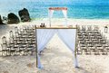 Wedding arch on the beach and chairs Stock Images