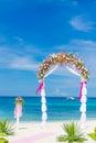 Wedding arch cabana gazebo on tropical beach decorated with flowers decoration Stock Photos