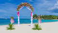 Wedding arch cabana gazebo on tropical beach decorated with flowers decoration Stock Photo