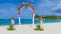 Wedding arch cabana gazebo on tropical beach decorated with flowers decoration Stock Photo