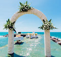 Wedding arch and chairs on the empty beach Stock Image