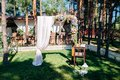Wedding arch decorated with flowers in the forest Royalty Free Stock Photo