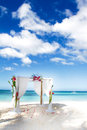 Wedding arch with flowers on beach decorated Stock Photos