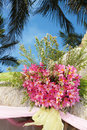 Wedding arch and set up with flowers on tropical beach Royalty Free Stock Photo