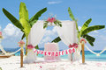 Wedding arch tent decorated with flowers on beach tropical ceremony set up Royalty Free Stock Photos