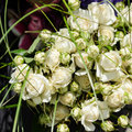 Wedding arrangement with little white roses and long green leaves Royalty Free Stock Photos