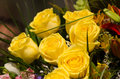 Wedding arrangement with yellow roses and other flowers Stock Images