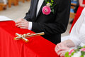 Wedding atmosphere bridal hands on and groom hands with wooden cross in middle focused to the cross Stock Images