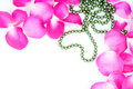Wedding background with beads and rose petals Stock Photography