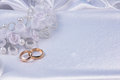 Wedding background weddings golden rings on white silk Royalty Free Stock Image