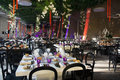 Wedding banquet tables decoration party or business event in amber purple red crystal silver white and black silvery candelabrums Royalty Free Stock Photography