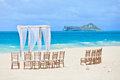 Wedding beach archway and chairs on tropical Royalty Free Stock Photography