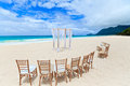 Wedding beach archway and chairs on tropical Stock Photos