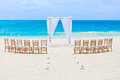 Wedding beach archway and chairs on tropical Royalty Free Stock Images