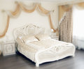 Wedding bed interior with a the photo in yellow tone Royalty Free Stock Photos