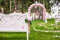 Wedding benches and flower arch for ceremony a outdoors Royalty Free Stock Photos