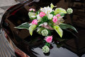 Wedding boquet on expensive car cowl black Stock Photography