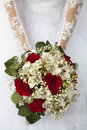 Wedding bouquet against a dress Stock Photos