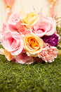 Wedding bouquet beautiful flowers on the green grass Royalty Free Stock Image