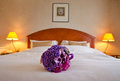 Wedding bouquet on the bed Royalty Free Stock Photo