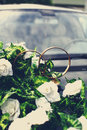 Wedding bouquet and big golden rings Stock Images