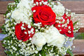 Wedding bouquet on the boards red and white roses Royalty Free Stock Images