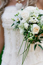 Wedding bouquet in bridal hands Stock Images