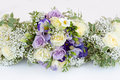 Wedding bouquet of bride and bridesmaids purple roses Stock Photo