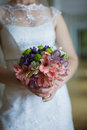 Wedding bouquet bride holding selective focus on a Stock Image