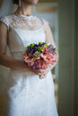 Wedding bouquet bride holding selective focus on a Royalty Free Stock Photography