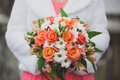 Wedding bouquet in the bride s hands flowers with colored flowers Royalty Free Stock Images