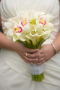 Wedding bouquet calla lily flowers in hands of bride Royalty Free Stock Image