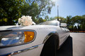 Wedding bouquet on the car decorated with Stock Images
