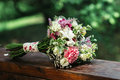 Wedding bouquet of carnations and roses, on a wooden table Royalty Free Stock Photo