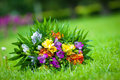 Wedding bouquet with colorful spring freesia flowers on a grass lawn Stock Images