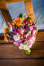Wedding bouquet a colorful on a wooden bench with blue lit background Stock Images