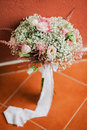 Wedding bouquet in creamy fine art style with roses Stock Photo