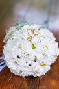 Wedding bouquet of dasies and rings beautiful Royalty Free Stock Images