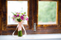 Wedding bouquet of flowers on the window background holding place Stock Image
