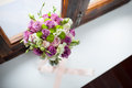 Wedding bouquet of flowers on the window background holding place Stock Photo
